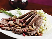 Sliced Brisket with Cranberries and Mushrooms; Served with Mashed Potatoes