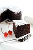 Moist chocolate cake dusted with icing sugar (Morocco)