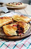 Puff pastry pockets filled with ham, tomato, mushrooms and mozzarella cheese
