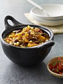 Vegetable Chili in a Cast Iron Crock; Bowl of Salsa