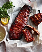 Rack of sticky pork ribs with lemon
