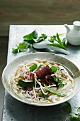 Bowl of pho soup with noodles