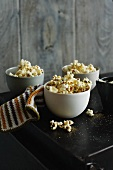 Bowls of flavored popcorn on table