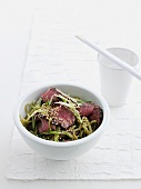 Bowl of beef and green tea noodles