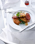 Plate of corn fritters with bacon
