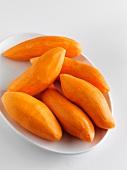 Whole Peeled Sweet Potatoes on a Dish