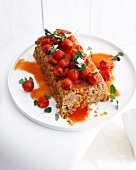 Plate of meatloaf with tomatoes