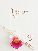 Close up of chopsticks with flowers