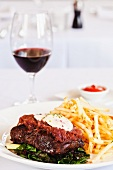 A steak with shallots and chips