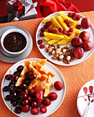 Plates of fresh fruit and nuts