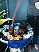 Pork chops being turned on a barbecue