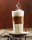 A glass of steaming latte macchiato