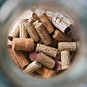 Corks in a glass container
