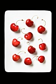 Ten Cherries on a White Plate; From Above