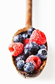 Washed Raspberries and Blueberries on a Wooden Spoon