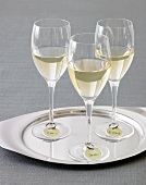 Three Glasses of White Wine with Name Tags on a Silver Tray