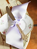 Knife Tied with a Lavender Ribbon on a Pretty Dessert Plate