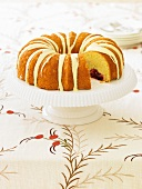 Cranberry Bundt Cake with Icing; Slice Removed