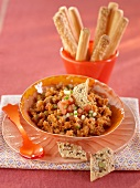 Tomato dip with crackers and grissini
