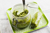 Pesto in a jar and wrapped in cling film