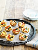 Ham, spinach and tomato tartlets