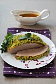Roast pork with a vegetable crust and gravy
