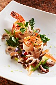 Fried king prawns, scallops and squid on a lukewarm avocado and tomato salad