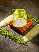 Monk fish fillet wrapped in courgette on pepper barley and saffron foam