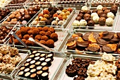 Many Chocolate Truffles and Sweets at the La Boqueria Market in Barcelona, Spain