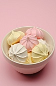 Bowl of Meringues on a Pink Background
