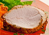 Slices of Roast Pork Loin with Mashed Sweet Potatoes and Snow Peas