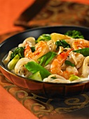 Thai noodle dish with seafood and vegetables