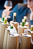 Blind wine tasting with wrapped up wine bottles