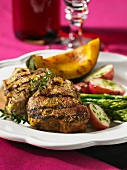 Grilled lamb chops with red-skinned potatoes, asparagus and pumpkin