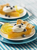 Lemon pie with whipped cream and fresh blueberries