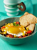 Tex Mex breakfast with a bean salad and a fried egg