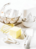 Baking utensils and ingredients (butter and eggs)