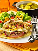 Tortillas filled with ham, artichokes and relish