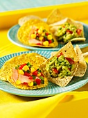 Tortilla chips with guacamole and corn relish