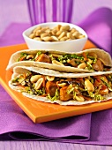 Tortillas with mu-shu chicken and peanuts