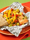 Salmon with peach salsa wrapped in aluminium foil