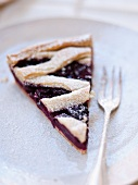 A slice of Linz-style cherry pie
