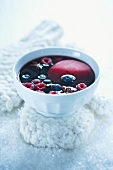 Red wine punch with apples and berries