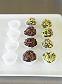 Truffle pralines decorated with chocolate sprinkles and pistachios