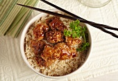 Orange Chicken Over Rice with Chopsticks