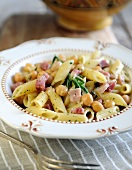 Penne pasta with chickpeas, pancetta and rosemary