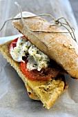 Chickpea cake, fresh tomato and mozzarella ciabatta sandwich