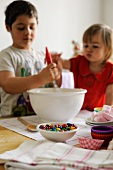 Young boy and girl mixing ingredients in a bowl