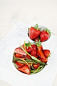 Cooked wild asparagus with strawberries in balsamic vinegar cream