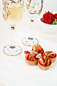 Strawberries and cherry tomatoes in a lime and olive oil marinade served in edible bowls